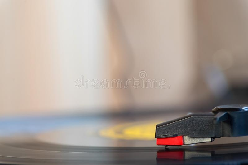 Turntable playing a vinyl. Close up Turntable playing a vinyl record royalty free stock image