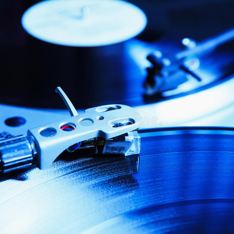 Turntable playing vinyl record with music. Useful equipment for DJ, nightclub and retro hipster theme or audio enthusiast royalty free stock photography