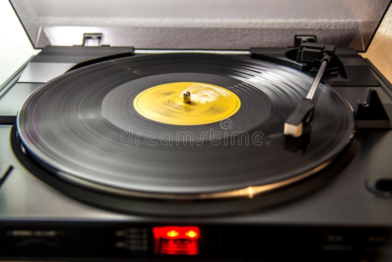 Analog turntable gramophone. Turntable system playing a vinyl record, old best music listening in analog way royalty free stock photography