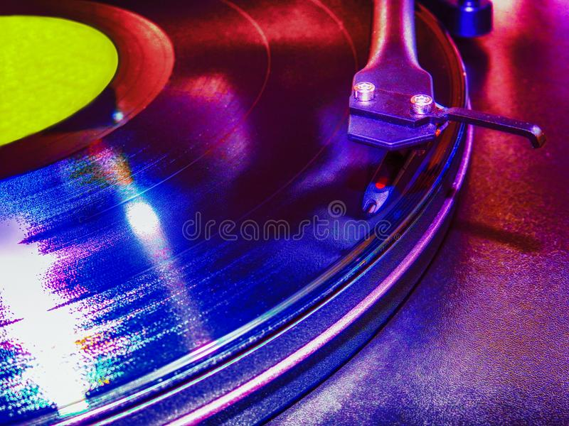 Turntable in the club. Turntable under the bright lights in the club stock image