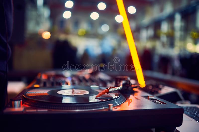 Turntable, vinyl record at night club. blured background.  stock images