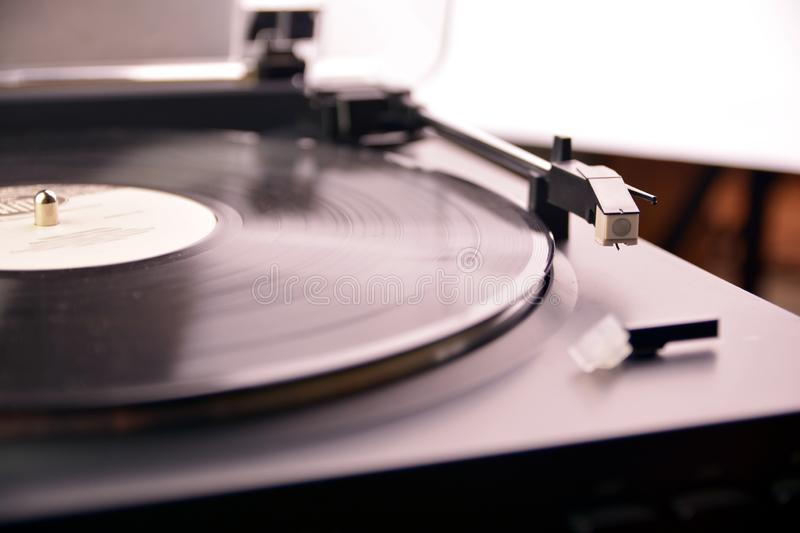 Turntable vinyl record player is playing music royalty free stock photos