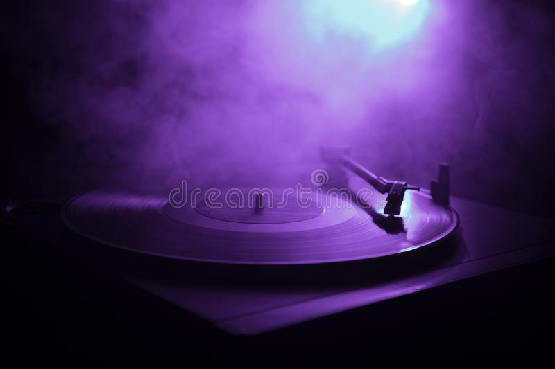 Turntable vinyl record player. Retro audio equipment for disc jockey. Sound technology for DJ to mix & play music. Vinyl record be. Ing played against burning royalty free stock image