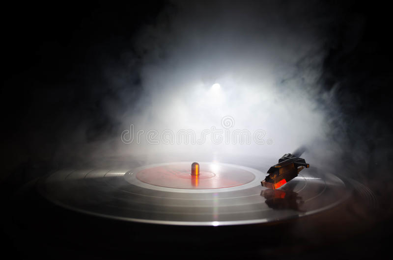 Turntable vinyl record player. Retro audio equipment for disc jockey. Sound technology for DJ to mix & play music. Vinyl record be. Ing played against burning royalty free stock images
