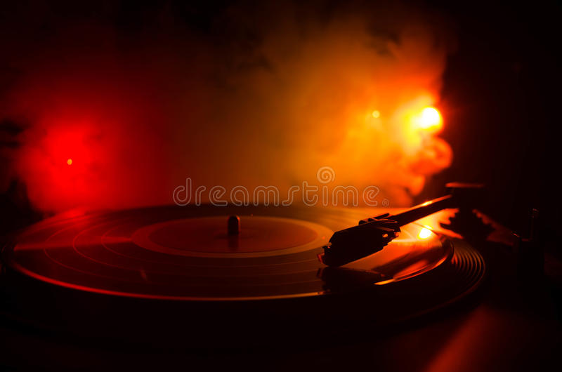 Turntable vinyl record player. Retro audio equipment for disc jockey. Sound technology for DJ to mix & play music. Vinyl record be. Ing played against burning royalty free stock photos