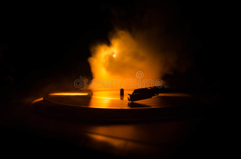 Turntable vinyl record player. Retro audio equipment for disc jockey. Sound technology for DJ to mix & play music. Vinyl record be. Ing played against burning royalty free stock photography