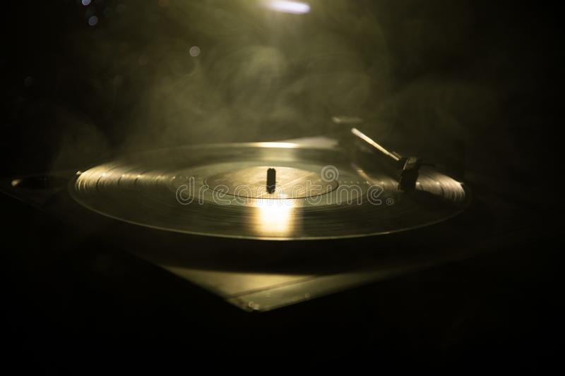 Turntable vinyl record player. Retro audio equipment for disc jockey. Sound technology for DJ to mix & play music. Vinyl record be. Ing played against burning royalty free stock photo