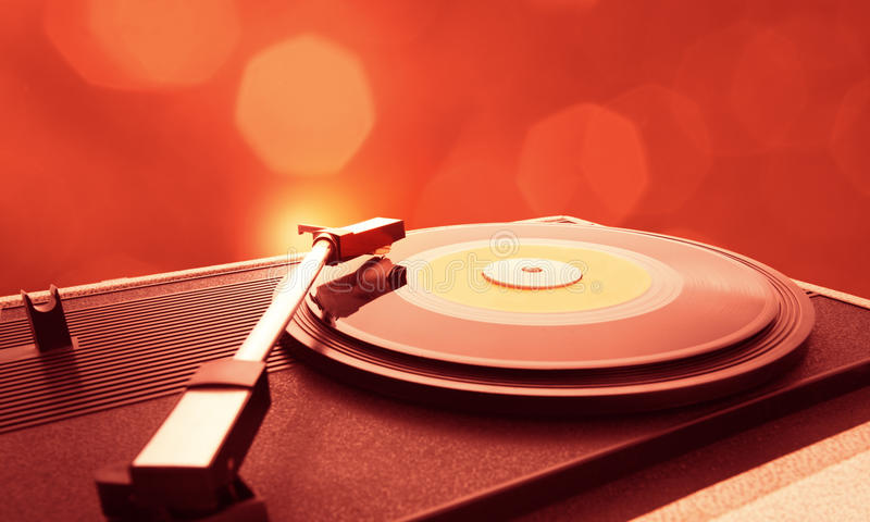 Turntable. A vinyl record is spinning on the turntable stock photography