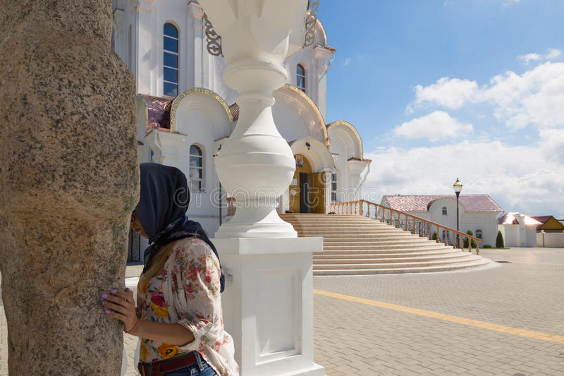Turov, Belarus - August 7, 2016: Cathedral of Saints Cyril and Lavrenti girl worships the holy stone of Turov June 28, 2013 in the royalty free stock images