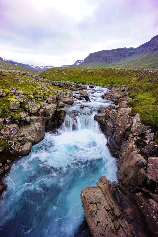 Turqouise waterfall Iceland stock photos