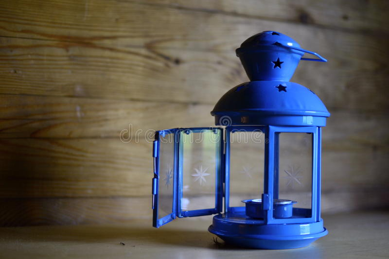 Blue turquoise small lamp for candles. Vintage blue turquoise handmade lamp for candles decorated with stars and glass still-life photography blurred background stock images