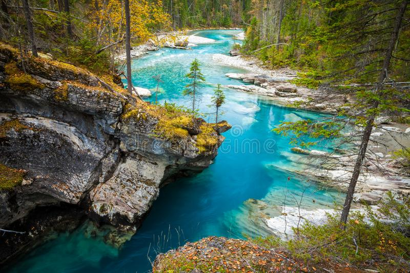 Turquoise blue river flowing through a canyon in the forest stock photos