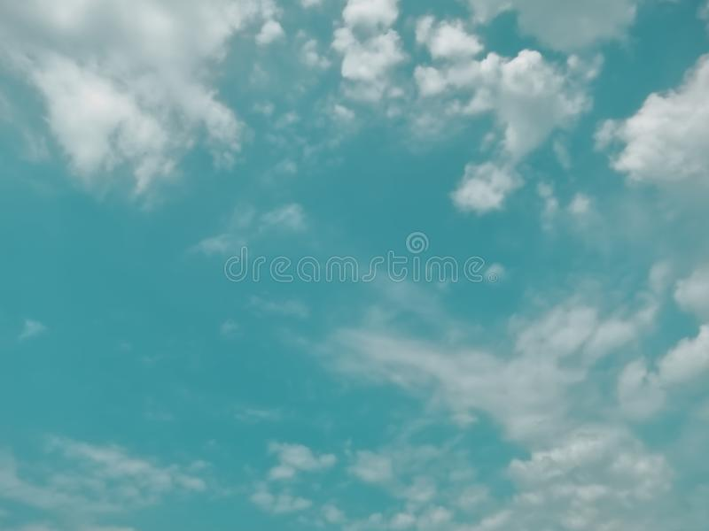 Turquoise Blue Sky background. White clouds wallpaper stock photography