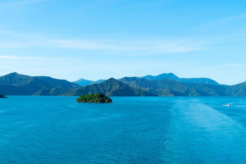 Turquoise blue water of Queen Charlotte Sound with surrounding hills and Motuora Island in Marlborough Sounds of South Island New royalty free stock image
