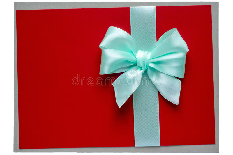 Turquoise bow and ribbon on red. Turquoise bow and ribbon on rough red background royalty free stock image