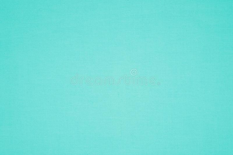 Turquoise colored canvas fabric texture stock image