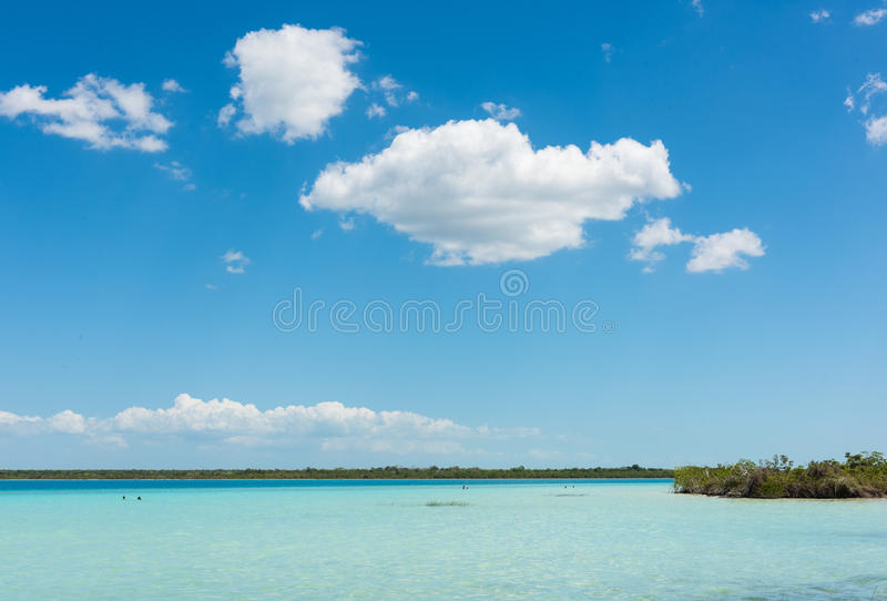 Turquoise colored water in Lake Bacalar. Mexico stock photography