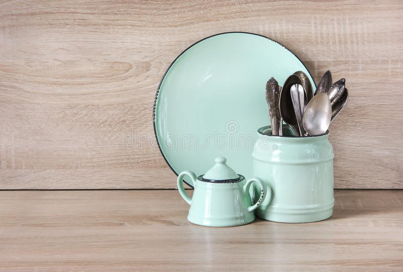 Turquoise crockery, tableware, dishware utensils and stuff on wooden table-top. Kitchen still life as background for design. Image with copy space royalty free stock photography