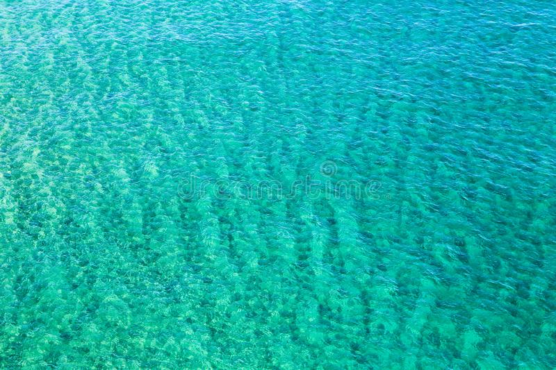 Turquoise and crystalline seawater stock photos