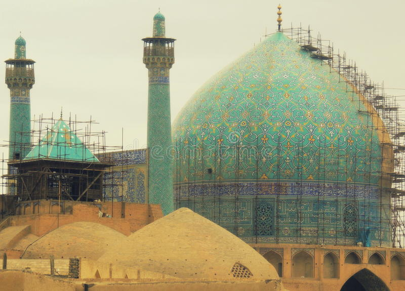 Turquoise dome Isfahan mosque and maintenance scaffolds stock image