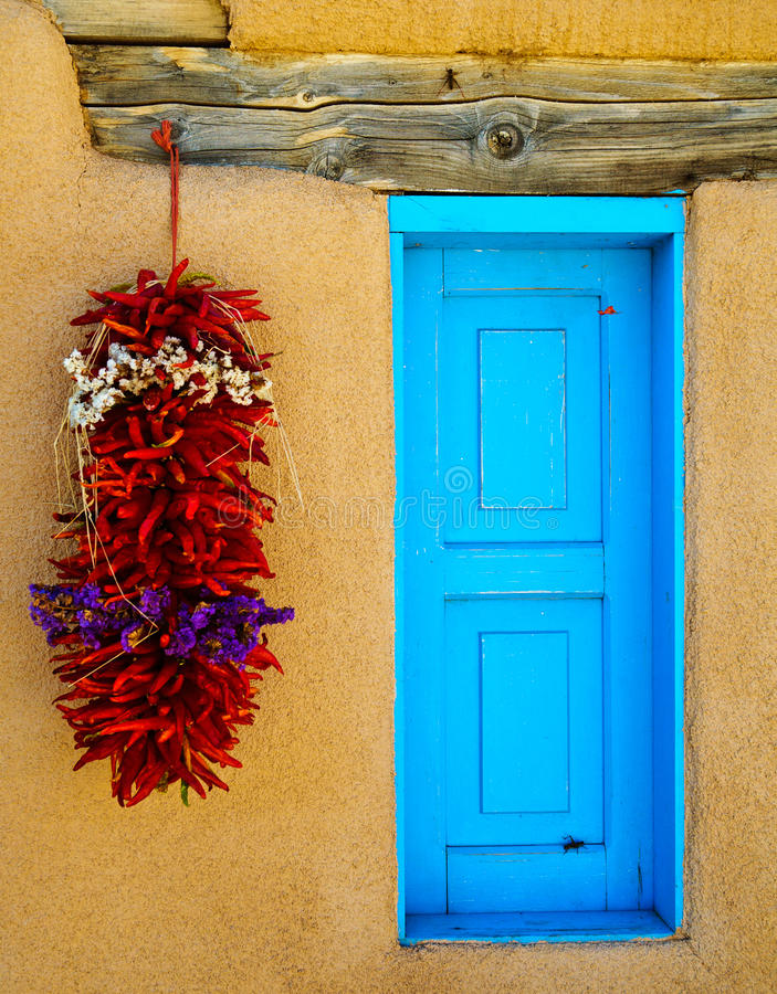 Adobe with Turquoise window stock images