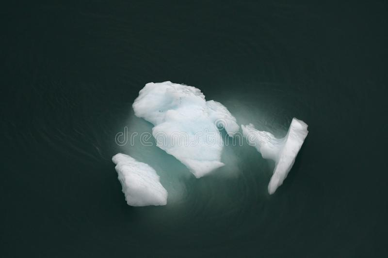 Turquoise glacial iceberg from above royalty free stock image