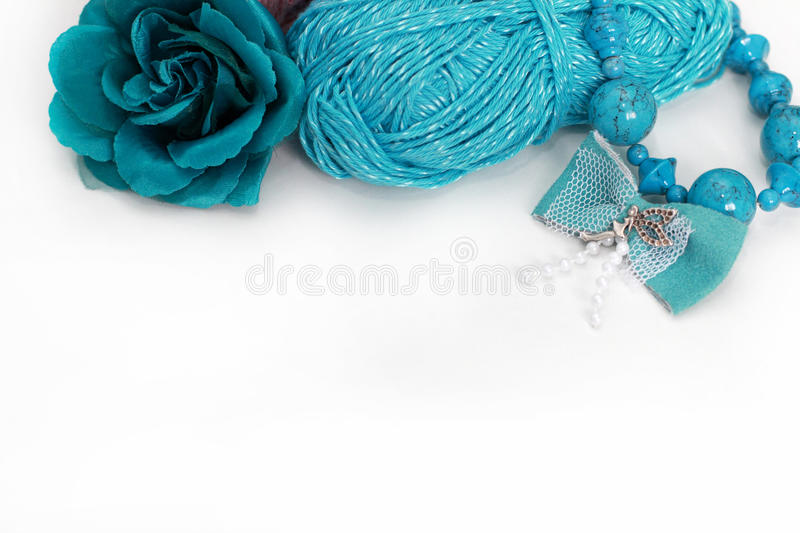 Turquoise handmade accessories. Skein, bow, beads, flower brooch stock images