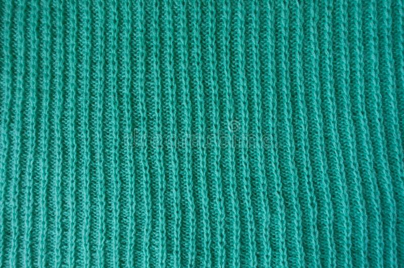 Turquoise knitted fabric with vertical rib pattern royalty free stock photos
