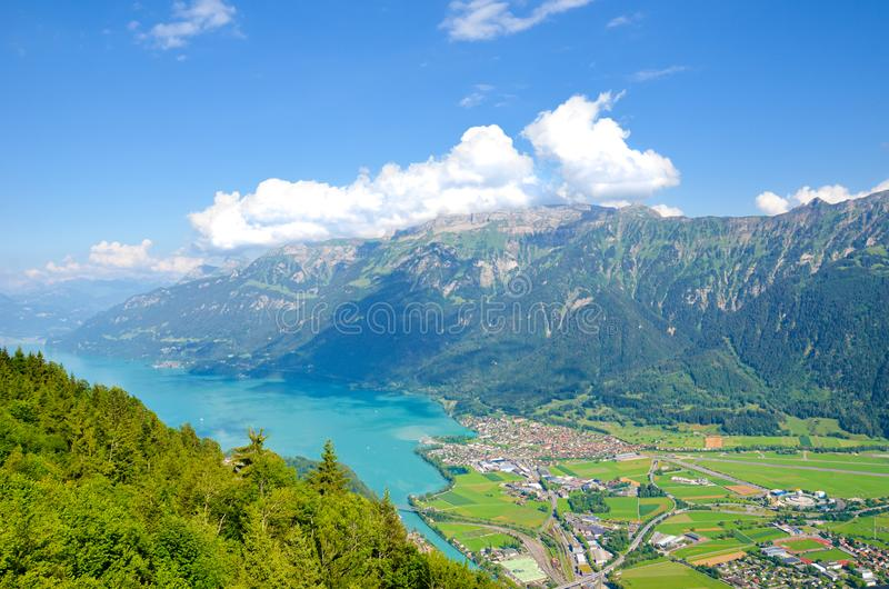 Turquoise Lake Brienz in Interlaken, Switzerland from above from Harder Kulm. Amazing Swiss landscape. Green hills, Swiss Alps. royalty free stock photography
