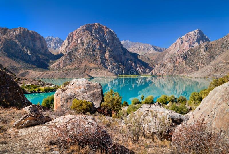 Turquoise lake in Fann mountains Iskanderkul royalty free stock images