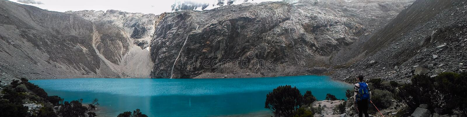 Turquoise lake laguna 69 located in White Cordillera in Peru. 'Laguna 69' is a breathtaking turquoise lake located in White Cordillera in Peru that stock photo