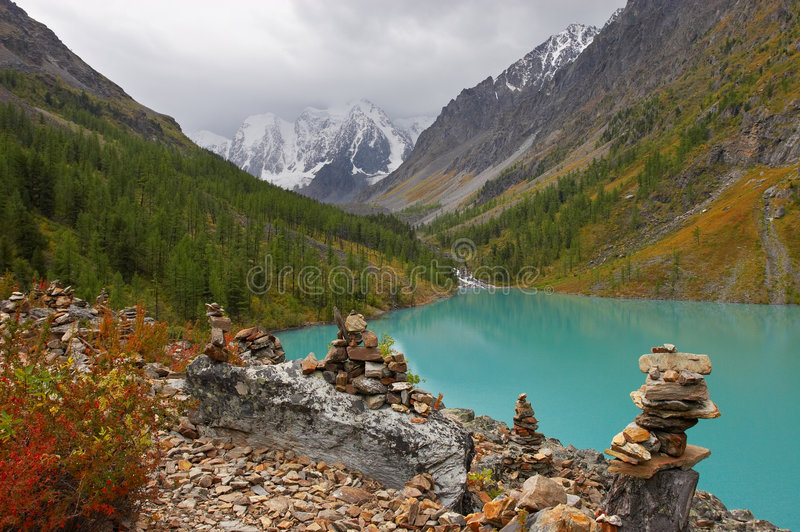 Turquoise lake and mountains. royalty free stock image