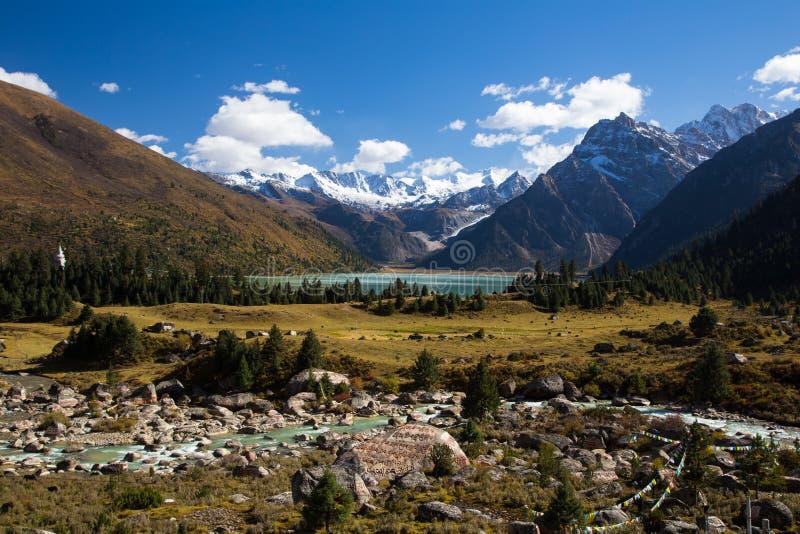 The turquoise lake Xinluhai in Tibet stock photos