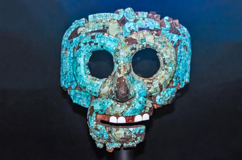 Turquoise mosaic Aztec mask from Mexico in British museum, London, UK royalty free stock photography