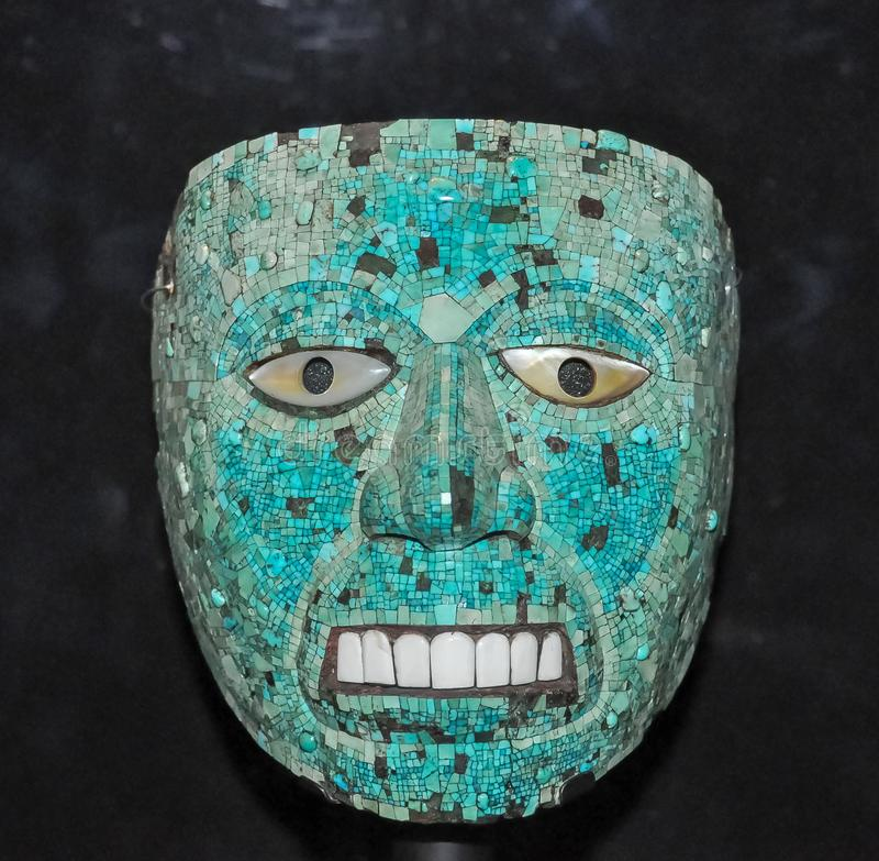 Turquoise mosaic Aztec mask Xiuhtecuhtli: God of Fire from Mexico in British museum, London, UK. Turquoise mosaic Aztec mask stock photo
