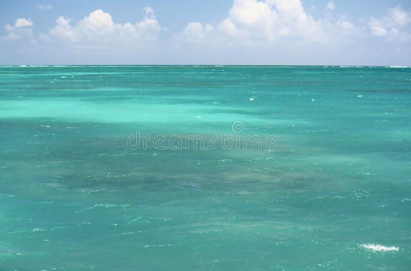 Turquoise ocean and blue sky stock photos