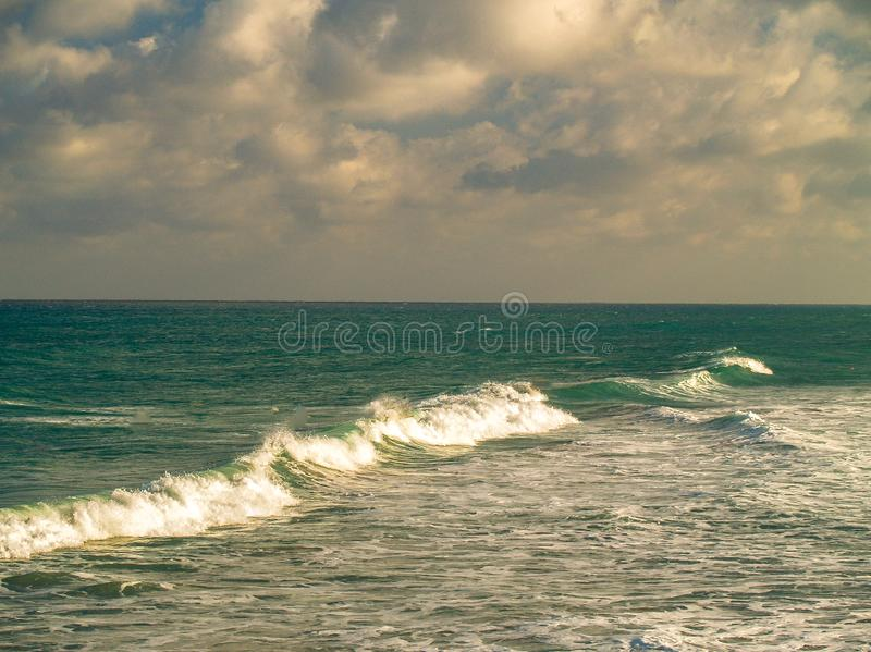 Canaveral National Seashore in Florida. Turquoise ocean surf and sand at Canaveral National Seashore in Florida royalty free stock photos
