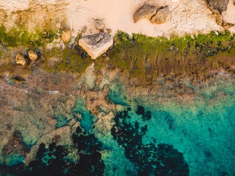 Turquoise ocean water with beach, aerial drone shot. Top view. Turquoise ocean water with beach, aerial drone shot royalty free stock photo