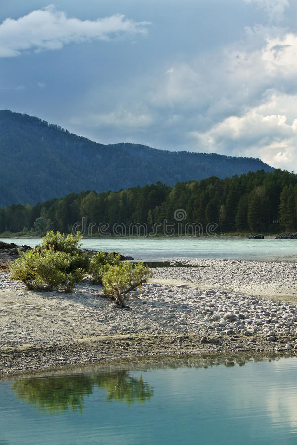 Turquoise river and mountains royalty free stock photography