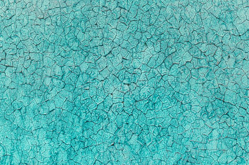 Turquoise rustic texture background with craquelure. Monochrome stock photo