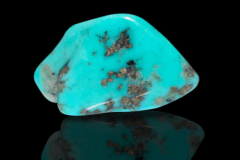 Turquoise. Sample of a beautiful Turquoise tumbled stone specimen isolated on black background stock image