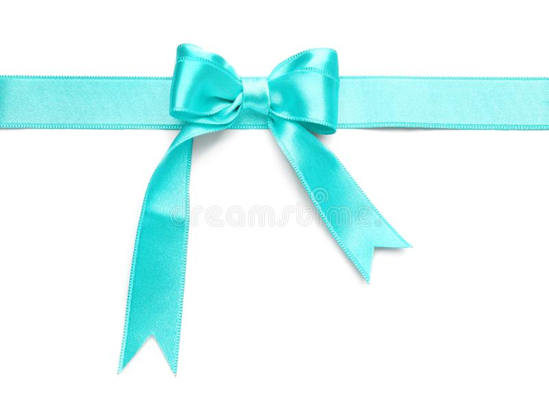 Turquoise satin ribbon with bow on white background royalty free stock images