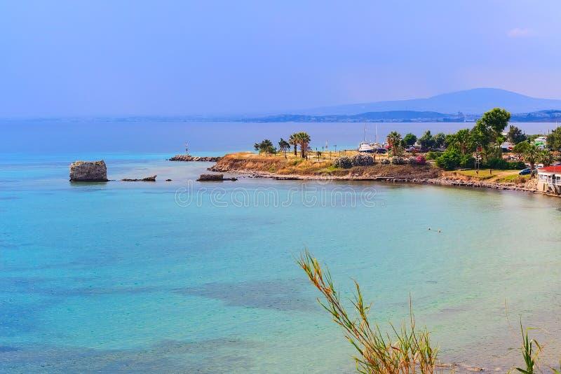 Nea Potidea or Nea Poteidea, Chalkidiki, Greece. Turquoise sea bay and old port of Nea Potidea or Nea Poteidea in peninsula Kassandra, Chalkidiki, Greece stock images
