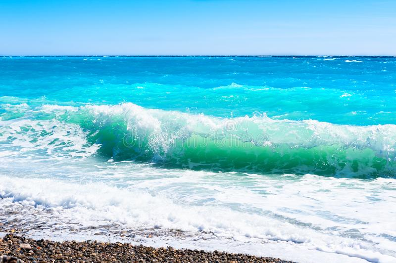 Turquoise sea and the blue sky. Beautiful beach in Nice, France. Cote d`azur, french riviera. Travel and vacation royalty free stock images