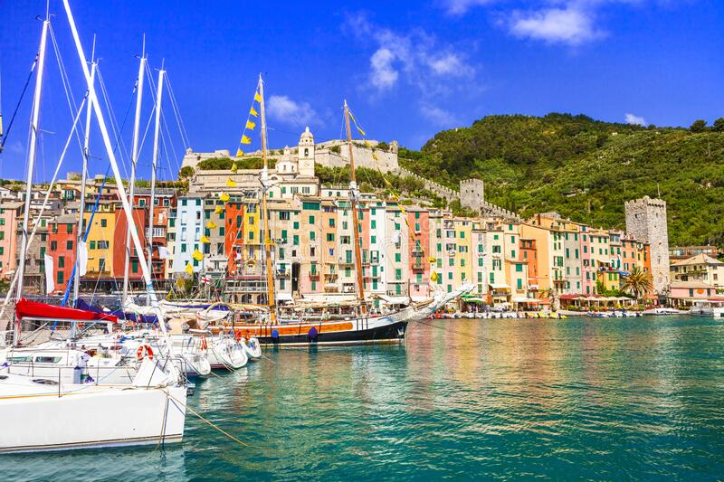 Turquoise sea,boats and colorful houses in Portovenere village,Cinque Terre,Liguria,Italy. royalty free stock image