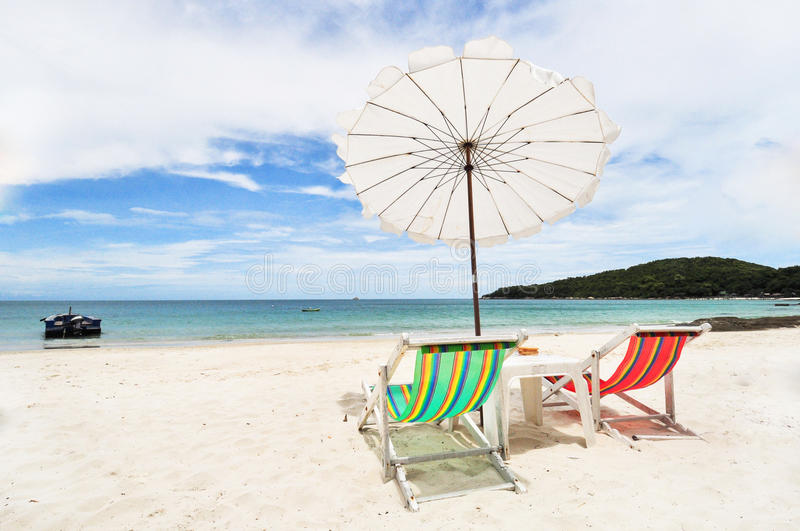 Turquoise sea, deckchairs, white sand stock photography