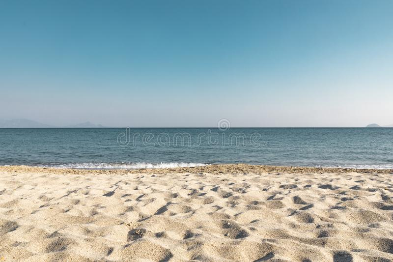 Turquoise Sea Horizon Line From Sand Beach. Landscape view of the horizon line over turquoise sea from sand beach royalty free stock images
