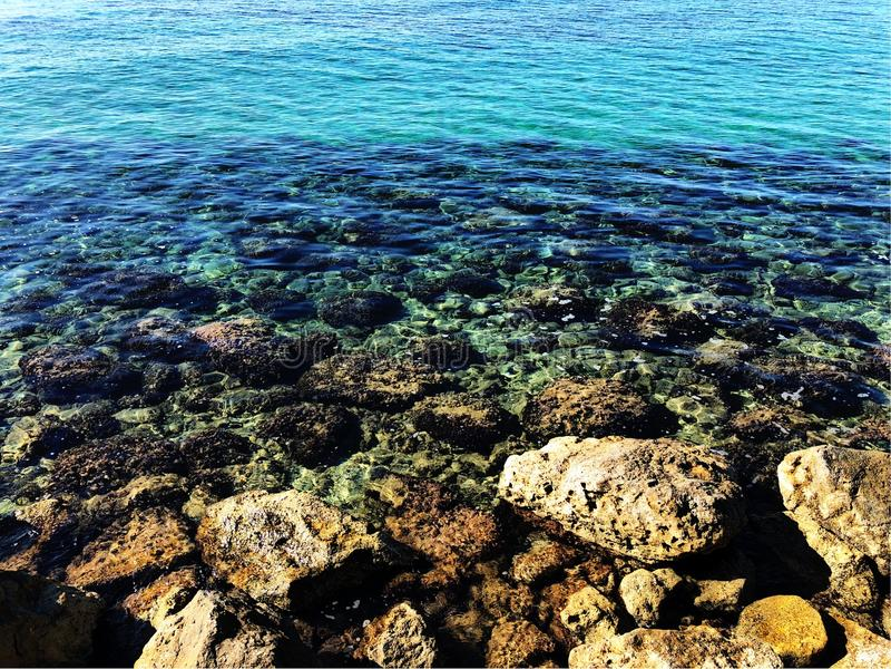 Turquoise sea with rocks stock photo