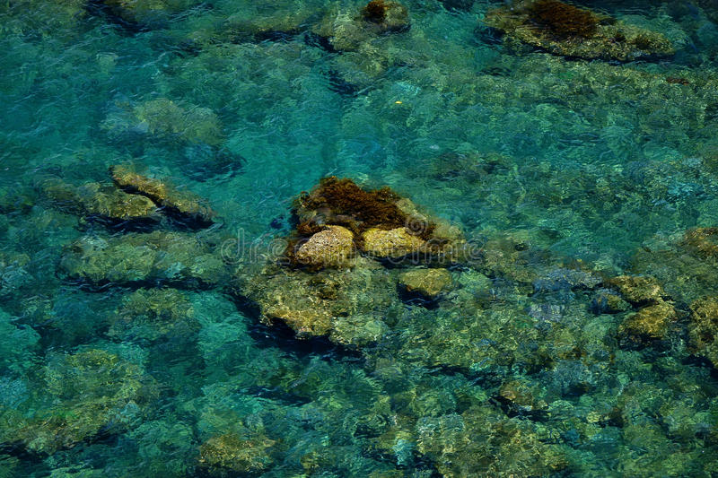 Turquoise sea with rocks. Background of turquoise sea with rocks royalty free stock images