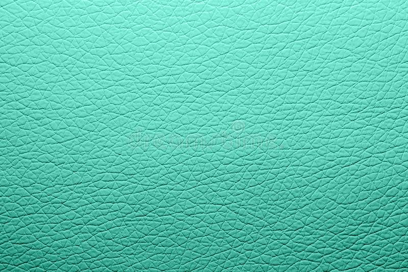 Turquoise skin texture.The background of the turquoise leather. royalty free stock image